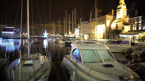 Beautiful yachts and boats moored in harbor near embankment, quiet city evening Footage