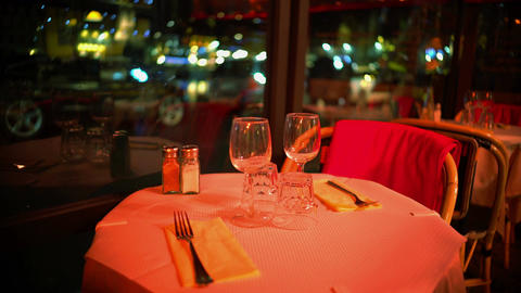 Wine glasses on table in restaurant, romantic pink light, celebration, date Footage
