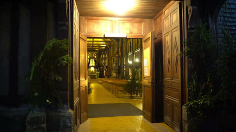 Entrance of old European church, open doors inviting visitors to the building Footage
