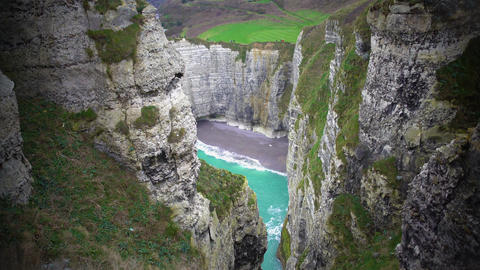 View on quiet private beach between white chalk cliffs in Etretat, France Footage