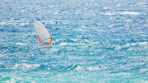 Extreme hobby, brave man competing in wave sailing, windsurfing in the ocean Footage