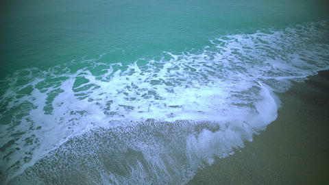 Calming view of sea waves washing sand beach, relaxing background, slow motion Footage