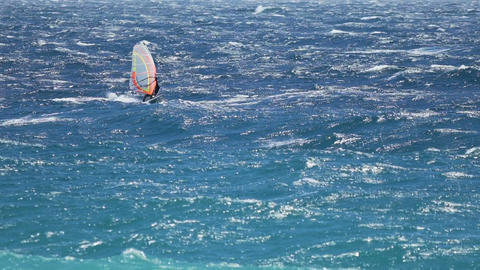 Light blue ocean and man windsurfing on waves, extreme sport, active lifestyle Footage