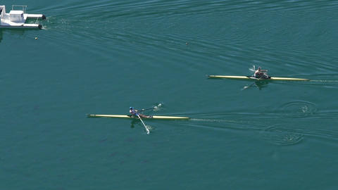 Professional athletes rowing boats at competition, water sports, slow motion Footage