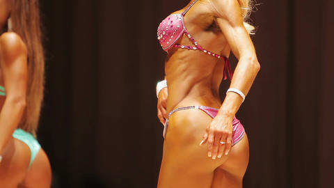 Female bodybuilder's perfect firm buttocks, fitness contest participant on stage Live Action