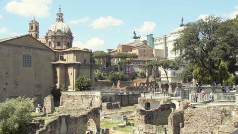 People walking around Roman Forum, famous landmark, sightseeing tour to Italy Footage