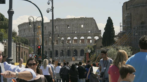 Crowded street near ancient Colosseum amphitheater in Rome, tourists in Italy Footage