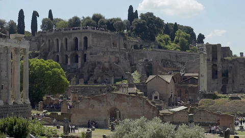 Crowds of tourists walking around Roman Forum, viewing ancient place of interest Footage