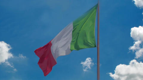 Italian flag flying against blue sky background, country's national symbol Footage