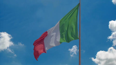 National flag of Italy flying in wind, blue sky background, prosperous country Live Action