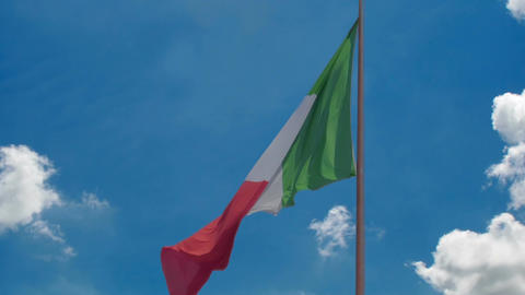 National flag of Italy flying in wind, blue sky... Stock Video Footage