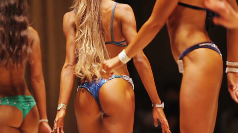 Sexy women walking in bikini at beauty contest, perfect slim feminine body Live Action