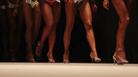 Legs of hot ladies walking on stage in bikini, performing at beauty contest Live Action