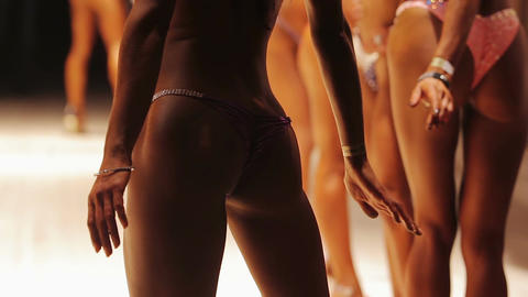 Ideal toned buttocks of model posing in bikini at fitness contest, bodybuilding Live Action