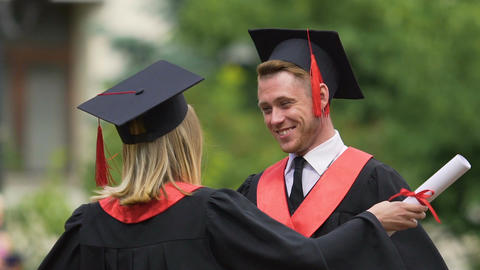 Sincere goodbye hug of best male and female friends graduating from university Footage