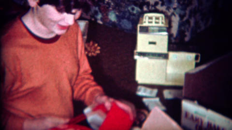 1970: Boy gets basketball hoop for Christmas gift Footage