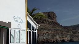 Spain Gran Canary Mogán 050 restaurant and mountain landscape Footage