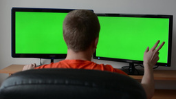 man works on the computer (monitor), touch screen - greenscreen ビデオ