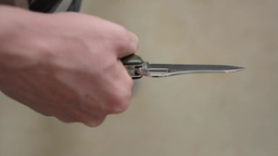 man holds a combat knife Footage