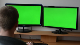 Man works on the computer - green screen. Man typing on the keyboard Footage