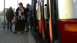 PRAGUE, CZECH REPUBLIC - APRIL 2014: Busy street and the bus stop with people Footage
