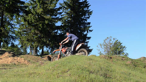 Bikers who give cross motorcycle over the bumps of the forest 01 Footage