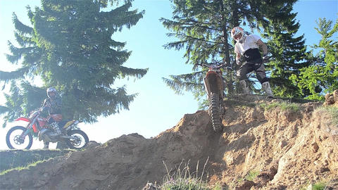 Bikers who give cross motorcycle over the bumps of the forest 02 Footage