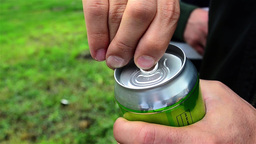 He pry the lid of a beer cans 2 Footage