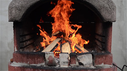 Wood burning, and the fire is big in a barbecue prepared for preparation of f Live Action