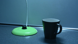 Switching on the kettle with cup on the kitchen counter Footage