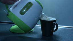 Boil water in a kettle and pouring tea on the kitchen counter Footage