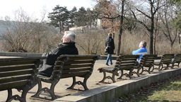 PRAGUE, CZECH REPUBLIC - MARCH 2014: People Relax In The Park, Sits On A Bench A stock footage