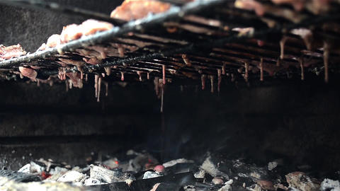 Grease dripping from pieces of meat placed at grilled Footage