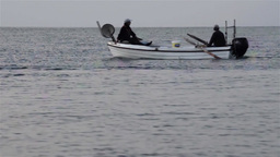 Boat with two fishermen move in the early hours of the morning, to place fishing Footage
