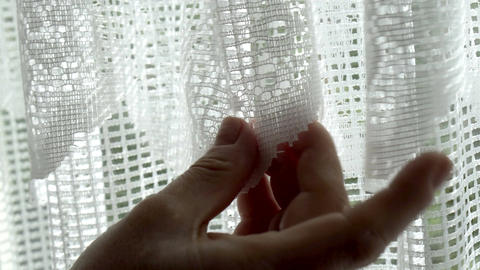 Extreme Closeup of Anonymous Woman Looking at Lace Window Curtains Footage
