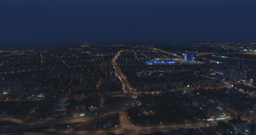 Illuminated streets of a city at night. Aerial Filmmaterial