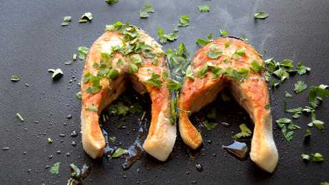 Coriander Thrown Onto Slices of Salmon Live Action