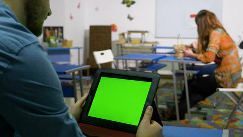 Young entrepreneur man using tablet pc with green screen in a training room Footage