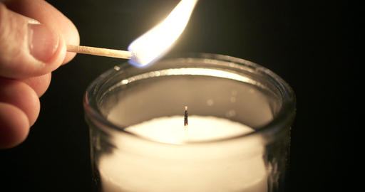 Slow motion Close up shot of a large white candle ビデオ
