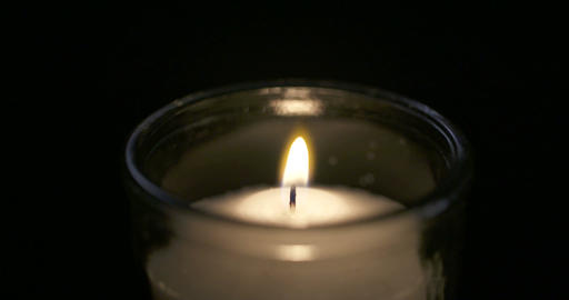 Slow motion Close up shot of a large white candle GIF