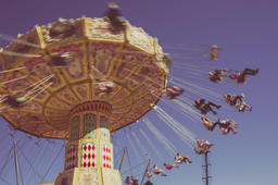 Spinning Carousel people with Vintage Vignette. Copyspace フォト
