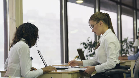 Female boss satisfied with trainee, shaking hand and hiring young lady for job Footage