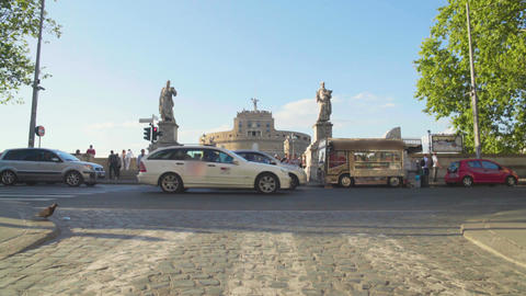 Busy street traffic near Castel Sant Angelo in Rome, urban life, transportation Footage