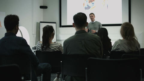 Professor teaching with projector Footage