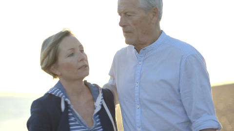 Portrait of Retired Senior Couple kissing on the beach Footage