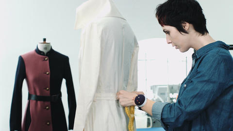 Fashion designer measuring mannequin in studio Footage