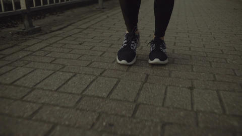 Close up of female runner feet on path Footage