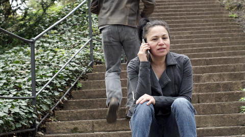 Woman in Mobile Phone Call on Outdoor Stairs Person Walks Up Steps Filmmaterial