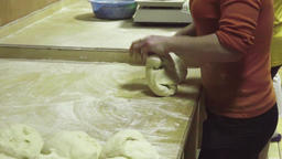 Baker kneading dough in flour on table HD slow-motion video. Bread production Filmmaterial