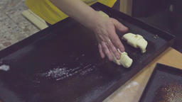 Baker lay out raw croissant to tray before baking HD video Bakery prepare pastry Footage